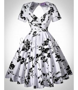 Biele retro šaty s čiernymi kvetinami