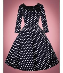 Tmavomodré bodkované vintage šaty